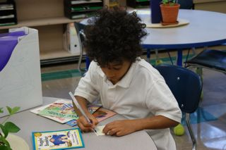 <center> A student works on his sight words.</center>